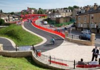 Sustrans Red Bridge with cyclist on it